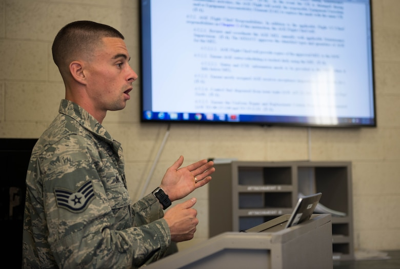 Staff Sgt. Garret Jimenez, 56th Equipment Maintenance Squadron, aerospace ground equipment training instructor, speaks to students during classroom training at Luke Air Force Base, Ariz., Feb. 8, 2018. Since implementing the new program, 12 Airmen have graduated, completing 22 five-level core tasks. (U.S. Air Force photo/Airman 1st Class Alexander Cook)