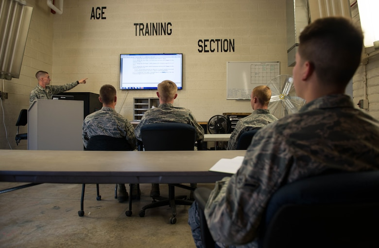 Airmen assigned to the 56th Equipment Maintenance Squadron Aerospace Ground Equipment flight participate in classroom training as part of a new accelerated upgrade training program implemented at Luke Air Force Base, Ariz., Feb. 8, 2018. The purpose of the program is to train newly assigned three-level AGE apprentices on F-16 Fighting Falcon and F-35A Lightning II servicing inspections. (U.S. Air Force photo/Airman 1st Class Alexander Cook)