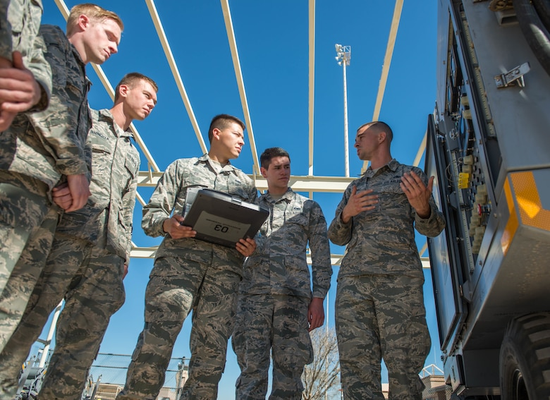 Staff Sgt. Garret Jimenez, 56th Equipment Maintenance Squadron, aerospace ground equipment training instructor, teaches three-level Airmen assigned to the AGE Flight how to perform pre-operation inspection procedures on an aircraft servicing cart as part of the new upgrade training program at Luke Air Force Base, Ariz., Feb. 8, 2018. The purpose of the program is to expedite training for newly assigned three-level Airmen by providing a combination of performance and written evaluations. (U.S. Air Force photo/Airman 1st Class Alexander Cook)