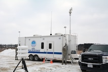 Senior Airman Cory Corson, left, and Staff Sgt. Shane Goss, Emergency Management Specialists with the 115th Fighter Wing, set up the Wisconsin Air National Guard All Hazards Emergency Response Trailer for the State Interoperable Mobile Communications Exercise (SIMCOM), in Fitchburg, Wis., Feb 7, 2018. The annual SIMCOM exercise tests the interoperability of federal, state and local emergency communications agencies. (U.S. Air National Guard photo by Tech. Sgt. Mary Greenwood)