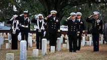 Marines and Sailors salute the headstone of Petty Officer 1st Class William Pinckney while Taps is played at the Beaufort National Cemetery, Feb. 10.