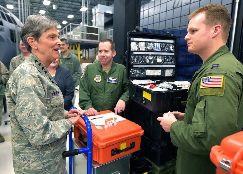 Gen. Ellen Pawlikowski, Air Force Materiel Command commander, discuss job responsibilities with Captains Paul Merrill and Matthew Decker, 375th Operations Group instructors and examiners, during her tour of the U.S. Air Force School of Aerospace Medicine at Wright-Patterson Air Force Base, Ohio, Jan. 30, 2018.
