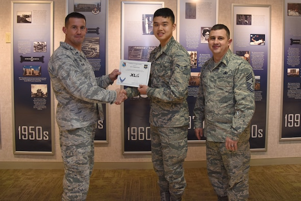 "Airman 1st Class Chansol Kim, 47th Medical Support Squadron referral management technician, was chosen by wing leadership to be the ""XLer"" of the week, for the week of Feb. 12, 2018. The ""XLer"" award, presented by Col. Charlie Velino, 47th Flying Training Wing commander, is given to those who consistently make outstanding contributions to their unit and the Laughlin mission. (U.S. Air Force photo/Airman 1st Class Marco A. Gomez)"