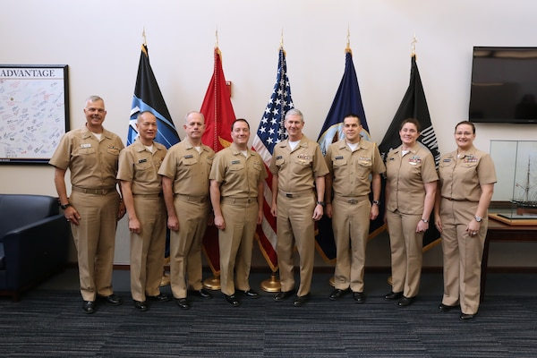 Naval Sea Systems Command (NAVSEA) Commander Vice Adm. Tom Moore (center) with the first group of Navy officers to wear the Engineering Duty Officer (EDO) qualification insignia Jan. 8, 2018 at the Washington Navy Yard.