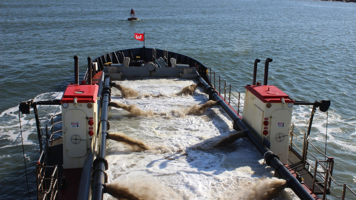 Dredge CURRITUCK fills her hull with a sand and water slurry pulled from the bottom of Ocean City Inlet while conducting Assateague Bypass operations Dec. 22, 2016. Assateague Bypass operations are part of environmental restoration efforts authorized to dredge material from in and around Ocean City Inlet to be placed offshore of Assateague Island to mitigate for erosion caused by the inlet and its jetties. (U.S. Army photo by Chris Gardner)
