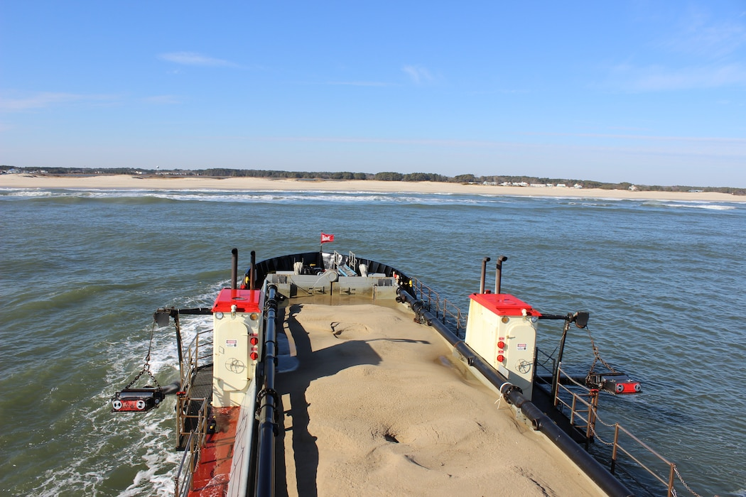 Dredge CURRITUCK prepares to empty a full load of sand offshore of Assateague Island that was just pulled from the bottom of Ocean City Inlet while conducting Assateague Bypass operations Dec. 22, 2016. Assateague Bypass operations are part of environmental restoration efforts authorized to dredge material from in and around Ocean City Inlet to be placed offshore of Assateague Island to mitigate for erosion caused by the inlet and its jetties. (U.S. Army photo by Chris Gardner)