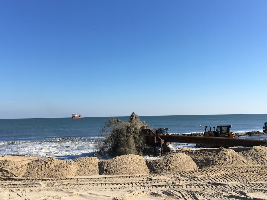 Crews carry out periodic renourishment work on the beach berm at Ocean City, Maryland Nov. 20, 2017 as part of the maintenance of the coastal storm risk management project there. The beach berm, essentially what most people think of as the beach, is engineered to reduce coastal storm risks in concert with the seawall and dune behind it. (U.S. Army photo by Chris Gardner)