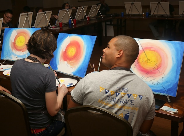 """Lance Cpl. Christian Moreno participates in a """"Singles Painting Party"""" aboard Marine Corps Air Station Beaufort, Feb. 14. The painting party was hosted by the Single Marine Program, a program that provides opportunities and improves the quality of life for single Marines and Sailors. Moreno is a videographer with MCAS Beaufort."""