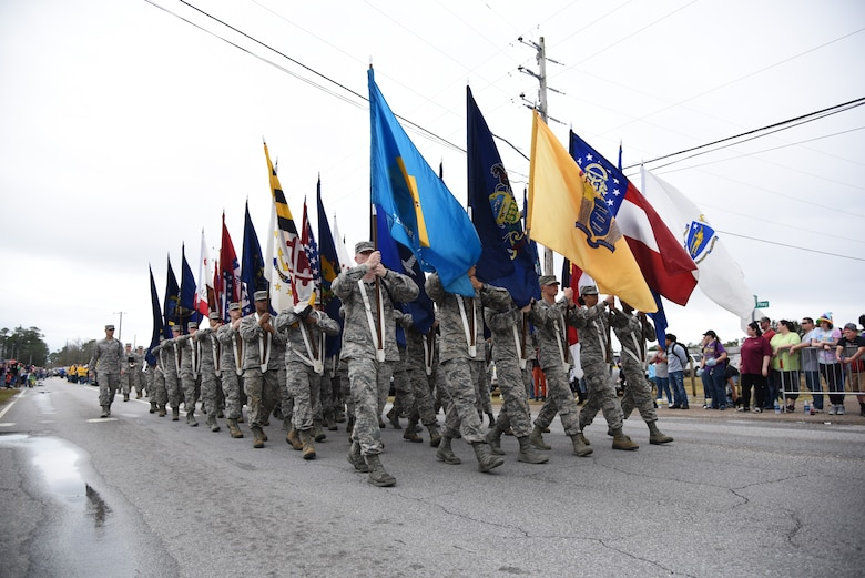 Keesler Airmen carry the 50 state flags in the North Bay Area Mardi Gras Parade Feb. 11, 2018, in D'Iberville, Mississippi. Keesler personnel participate in local parades every Mardi Gras season to show their support of the communities surrounding the installation. (U.S. Air Force photo by Kemberly Groue)