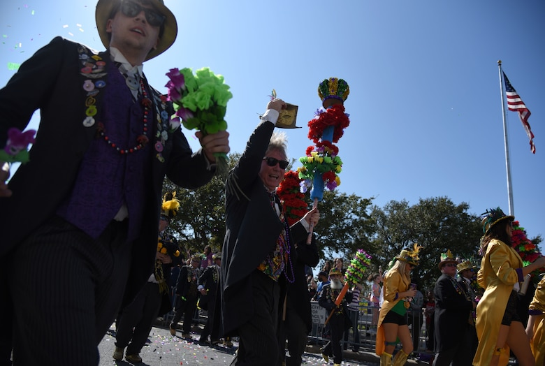 Members of the Ole Biloxi Marching Club participate in the Gulf Coast Carnival Association Mardi Gras parade Feb. 13, 2018, in Biloxi, Mississippi. Keesler personnel participate in local parades every Mardi Gras season to show their support of the communities surrounding the installation. (U.S. Air Force photo by Kemberly Groue)