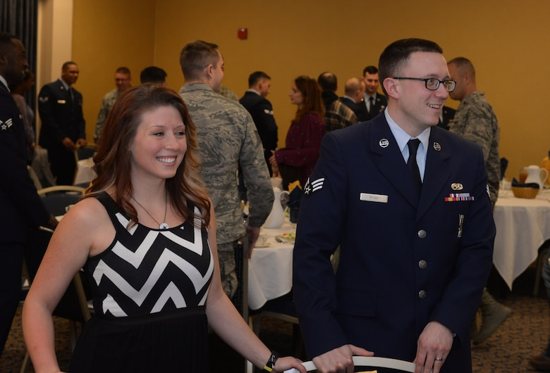 Heather Ryan, left, and her spouse Senior Airman Michael Ryan, a 28th Munitions Squadron armament systems crew member, mingle with other attendees during an Airman Leadership School graduation in the Dakota's Club at Ellsworth Air Force Base, S.D., Feb. 2, 2018. Prior to the graduation, spouses and their Airmen had the opportunity to attend the first spouse's orientation program, which provided attendees the chance to ask questions and receive clarification on issues such as appropriate attire and etiquette. (U.S. Air Force photo by Airman 1st Class Thomas I. Karol)