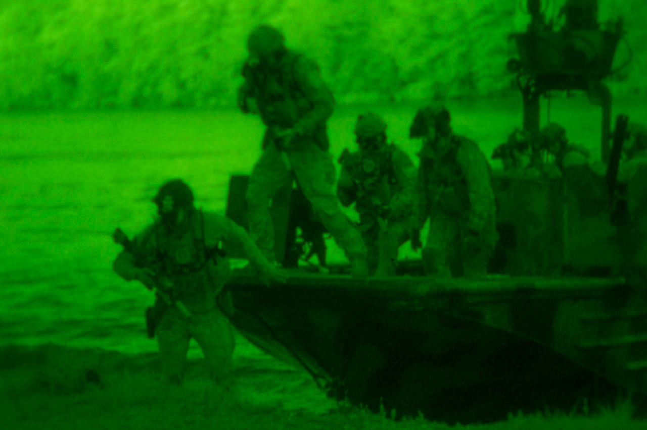 Night-vision photo of Navy SEALs in an exercise.