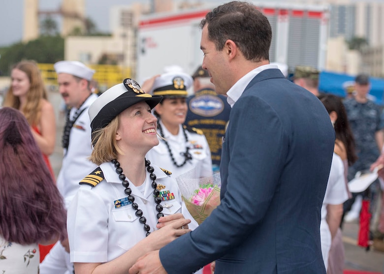 Lt. Cmdr. Amber Cowan, assigned to the Virginia-class fast-attack submarine USS Texas (SSN 775) and native of Colorado Springs, Colorado, greets her husband on the submarine pier in Joint Base Pearl Harbor-Hickam, Feb. 14.