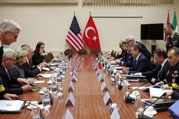 Defense Secretary James N. Mattis sits across a long table from his Turkish counterpart.
