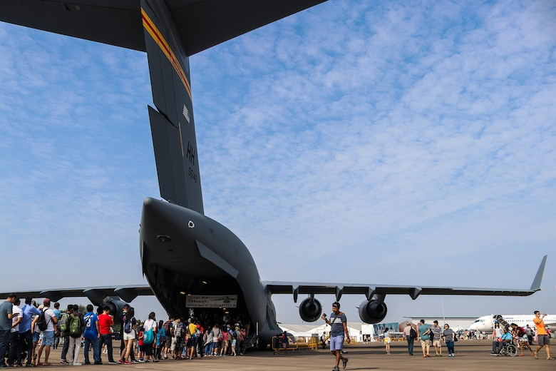 People wait in line to view the inside of a C-17 Globemaster III, during the Singapore International Airshow at Changi Exhibition Centre, Singapore, Feb. 10, 2018.