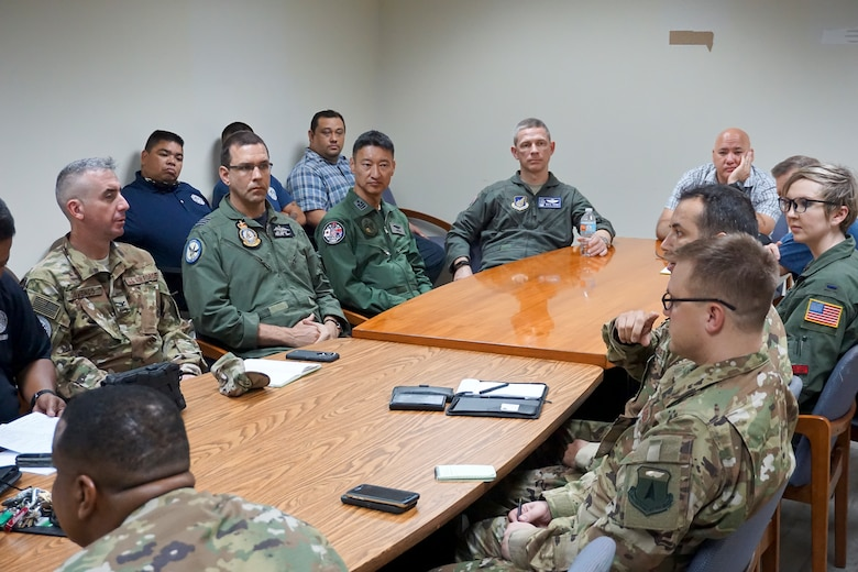 U.S. Air Force (USAF) Lt. Col. Jeremiah Castillo, 36th Mobility Response Squadron USAF director of operations, discusses humanitarian assistance/disaster relief (HA/DR) training with three COPE NORTH 2018 exercise directors and Saipan civil leaders and airport officials, Feb. 13. This year's COPE NORTH is an annual Pacific Air Forces tri-lateral HA/DR exercise with participants from the USAF, U.S. Navy, U.S. Marine Corps, Koku Jieitai (Japan Air Self-Defense Force), and Royal Australian Air Force. COPE NORTH is a model opportunity for expanding engagements with the Commonwealth of the Northern Mariana Islands.(U.S. Air Force photo by Capt. James Moore)
