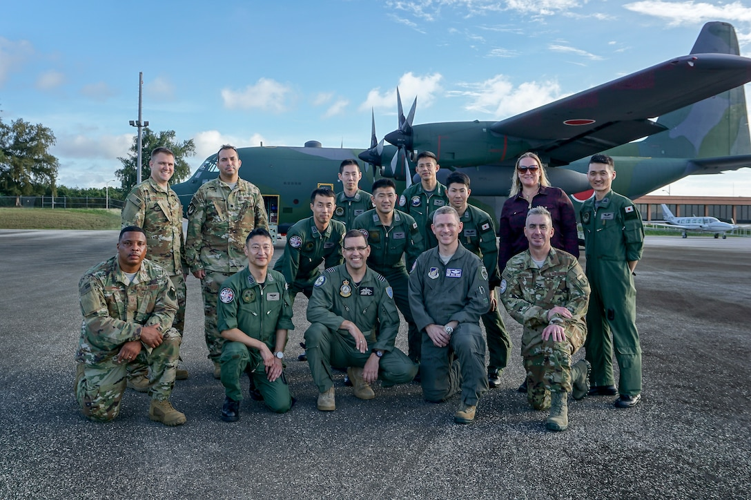 Personnel from U.S. Air Force (USAF) and Koku Jieitai (Japan Air Self-Defense Force) line up to board a JASDF C-130H Hercules during exercise COPE NORTH 2018, Feb. 13. This year's COPE NORTH is an annual Pacific Air Forces tri-lateral humanitarian assistance/disaster relief exercise with participants from the USAF, U.S. Navy, U.S. Marine Corps, Koku Jieitai (Japan Air Self-Defense Force), and Royal Australian Air Force. COPE NORTH is a model opportunity for expanding engagements with the Commonwealth of the Northern Mariana Islands. (U.S. Air Force photo by Capt. James Moore)