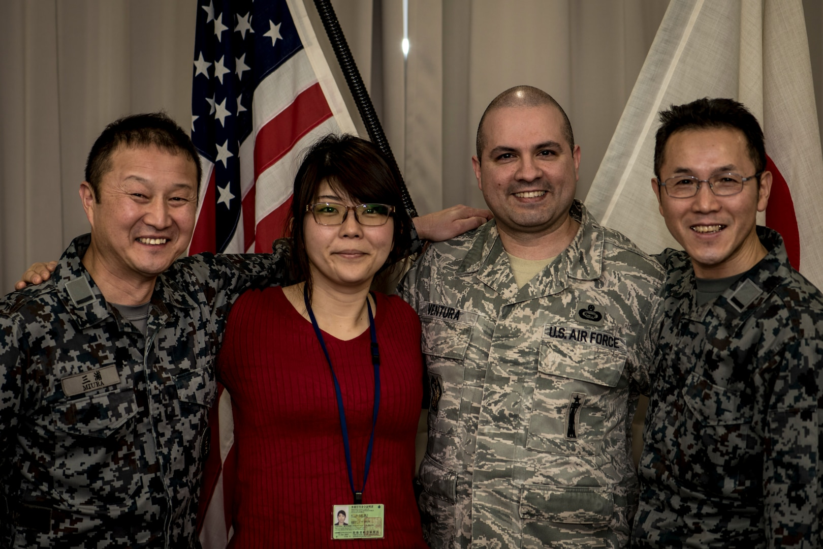 Japan Air Self-Defense Force Warrant Officer Junji Miura, left, the 3rd Air Wing command chief, Noriko Ohtani, center left, a 3rd AW U.S. Relations Section member, U.S. Air Force Master Sgt. Cesar Ventura, center right, a 35th Fighter Wing inspector general vertical inspections planner, and JASDF Warrant Officer Tsuyoshi Endo, right, the former 6th Air Defense Missile Group chief and Senior Noncommissioned Officer Association president, pose for a photo in the 3rd AW headquarters at Misawa Air Base, Japan, Feb. 14, 2018. In the past four years, Ventura worked with Miura, Endo and Ohtani on numerous bilateral events bringing U.S. and Japan servicemembers closer as allies and friends. Ventura attributes his success to his Hispanic upbringing and seeks new adventures every day where he can learn something new about another's culture. (U.S. Air Force photo by Tech. Sgt. Benjamin W. Stratton)