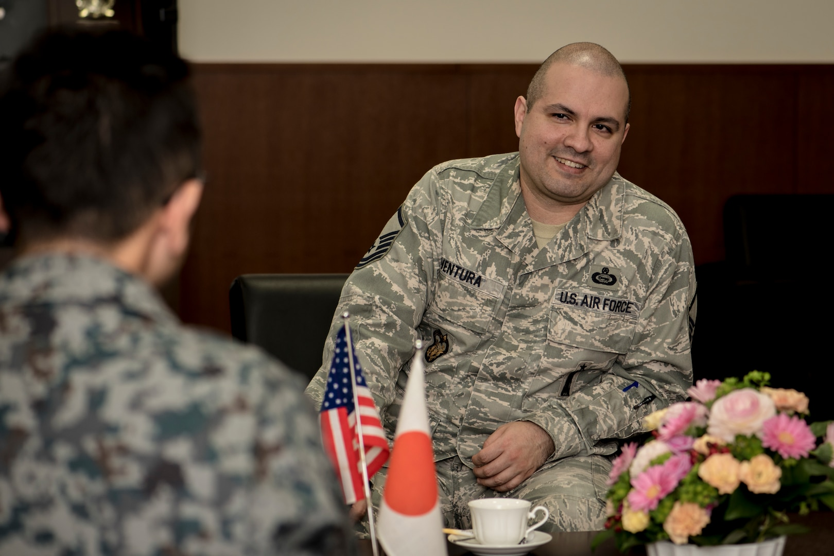 """U.S. Air Force Master Sgt. Cesar Ventura, right, a 35th Fighter Wing inspector general vertical inspections planner, and Japan Air Self-Defense Force Warrant Officer Tsuyoshi Endo, right, the former 6th Air Defense Missile Group chief and Senior Noncommissioned Officer Association president, exchange mutual thanks for Ventura's many years of service to JASDF in the 3rd Air Wing's headquarters at Misawa Air Base, Japan, Feb. 14, 2018. """"Vinny-san"""" as Endo refers to Ventura by, submitted him for his service's Special Class Award and on Dec. 13, 2017, JASDF Warrant Officer Junji Miura, the 3rd Air Wing command chief, presented the award on behalf of the Area Defense Command in Tokyo. (U.S. Air Force photo by Tech. Sgt. Benjamin W. Stratton)"""