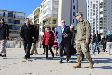 U.S. Army Corps of Engineers, Baltimore District Commander Col. Ed Chamberlayne walks and talks with Maryland Governor Larry Hogan and Maryland Secretary of Natural Resources Mark Belton while visiting ongoing beach renourishment activities in Ocean City, Maryland Nov. 20, 2017. The work is part of the coastal storm risk management project that reduces risks to Ocean City and is a cost-sharing partnership between the U.S. Army Corps of Engineers and the state of Maryland, as well as Worcester County and the Town of Ocean City. (U.S. Army photo by Becca Nappi)