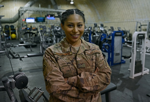 Senior Airman Astrid Hernandez, 455th Expeditionary Force Support Squadron contracting officer representative, poses for a photo in The Rock fitness center Feb. 13, 2018 at Bagram Airfield, Afghanistan.