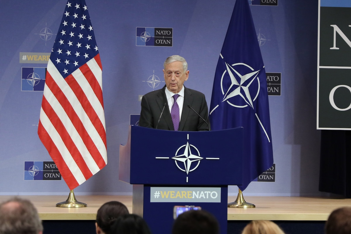 Defense Secretary James N. Mattis briefs reporters during a news conference in Brussels.