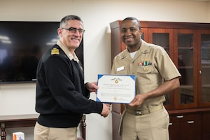Navy Lt. Ismael Tounkara, assigned to Naval Supply Systems Command Weapon Systems Support in Mechanicsburg, Pa., was recognized in an award ceremony, Jan. 19, 2018, by Navy Capt. Rudy Geisler, deputy commander for maritime. Navy photo by Dorie Heyer