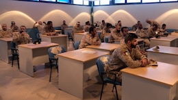 Twenty-seven Kuwaiti Marines gathered in a classroom at the Kuwait Naval Institute to attend the Tactical Resupply Subject Matter Expert Exchange with U.S. Marines from the Command Element and Logistics Combat Element, Special Purpose Marine Air-Ground Task Force – Crisis Response – Central Command. Exchanging logistic concepts and best practices allowed participants to learn from each other and strengthened relationships.