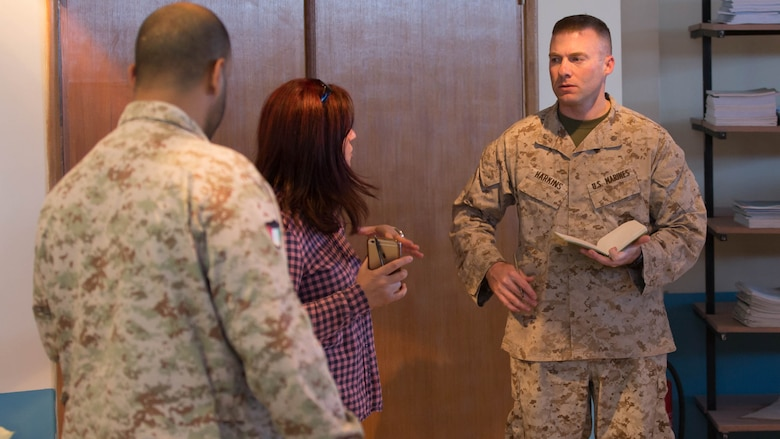 U.S. Marine Maj. Andrew Harkins, the logistics officer in charge for the Command Element, Special Purpose Marine Air-Ground Task Force – Crisis Response – Central Command (right) and a Kuwaiti Marine First Sgt. Bader M. Al-Hubaiter, an infantryman with the Kuwaiti Marine Battalion (left), discuss their respective organizations' logistics structure during a Tactical Resupply Subject Matter Expert Exchange held at the Kuwait Naval Institute. Participants exchanged logistic concepts and best practices to learn from each other and strengthen relationships.