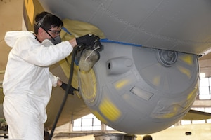 (02/05/2017) -- National Museum of the U.S. Air Force restoration specialist Casey Simmons paints the ball turret on the Boeing B-17F Memphis Belle. Plans call for the aircraft to be placed on permanent public display in the WWII Gallery here at the National Museum of the U.S. Air Force on May 17, 2018. (U.S. Air Force photo by Ken LaRock)