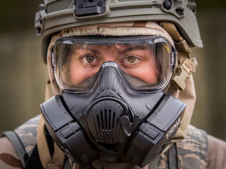 Airman Amanda Danforth, 96th Security Forces Squadron, watches the horizon during an alarm phase of a chemical, biological, radiological, nuclear and explosive training exercise at Eglin Air Force Base, Fla., Feb. 1, 2018. (U.S. Air Force photo by Samuel King Jr.)