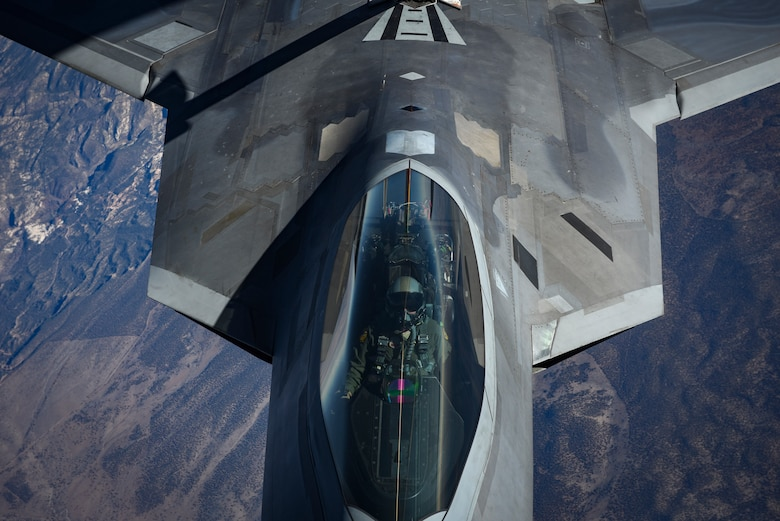 An F-22 Raptor assigned to the 27th Fighter Squadron at Joint Base Langley-Eustis, Va., receives fuel during Red Flag 18-1 over the Nevada Test and Training Range, Feb. 7, 2018. Red Flag helps pilots train for real-time war scenarios and tests their readiness for future conflicts. (U.S. Air Force photo by Airman 1st Class Andrew D. Sarver)