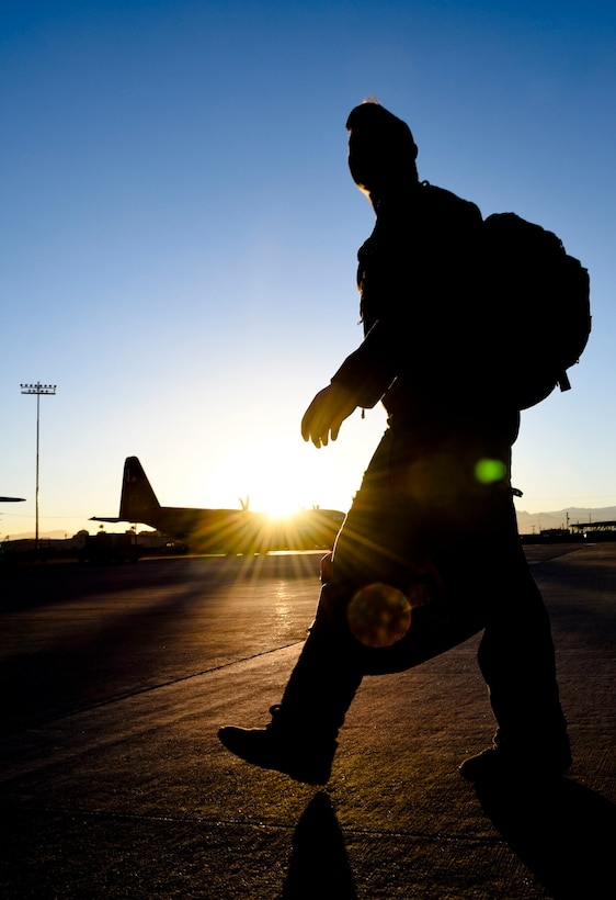 Senior Airman Dan Daley, a boom operator assigned to Fairchild Air Force Base, Wash., walks on the flightline during Red Flag 18-1, Feb. 7, 2018, at Nellis AFB, Nev. Red Flag gives Airmen an opportunity to experience realistic combat scenarios that prepares them for real-world conflicts. (U.S. Air Forcae photo by Airman 1st Class Andrew D. Sarver)