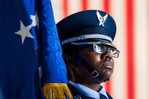 Airman 1st Class Myshanique Jones, Travis Air Force Base Honor Guard, holds the Air Force flag during the 75th anniversary kickoff celebration at Travis AFB, Calif., Feb. 8, 2018. Travis AFB is celebrating 75 years as a major strategic logistics hub for the Pacific and integral part of global power projection for the total force. (U.S. Air Force photo by Master Sgt. Joey Swafford)