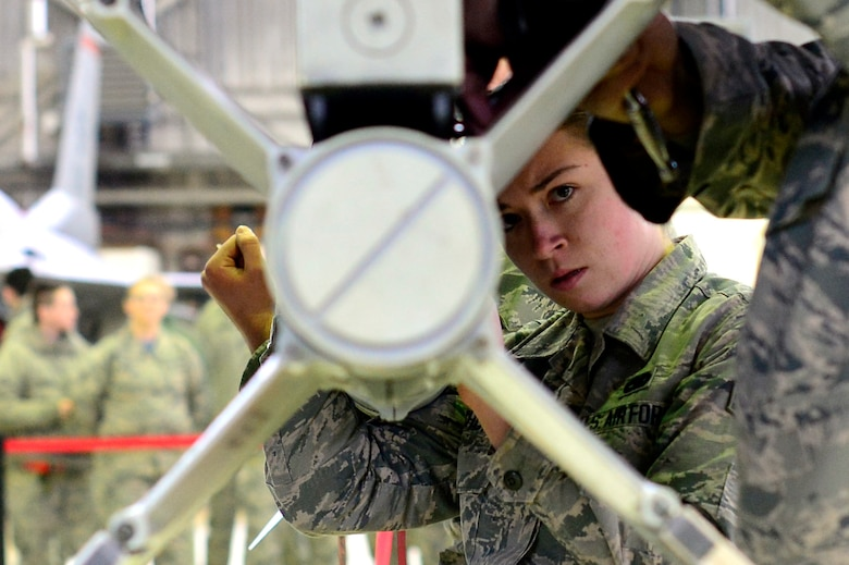 Senior Airman Haley Wolochowicz inspects a weapon for loading during a Weapons Load Crew Competition at Spangdahlem Air Base, Germany, Feb. 9, 2018. The competition featured two teams competing to be the wing's best load crew and the winners will be announced at their annual Maintenance Professional of the Year banquet. (U.S. Air Force photo by Tech. Sgt. Staci Kasischke)