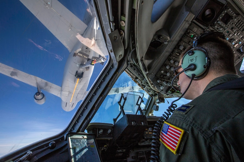 Capt. Thomas Beltz, C-17 Globemaster III pilot with the 514th Air Mobility Wing, closes in to refuel with a KC-10 Extender over the Atlantic Ocean, Feb. 10, 2018. The 514th AMW is an Air Force Reserve Command unit located at Joint Base McGuire-Dix-Lakehurst. (U.S. Air Force photo by Master Sgt. Mark C. Olsen)