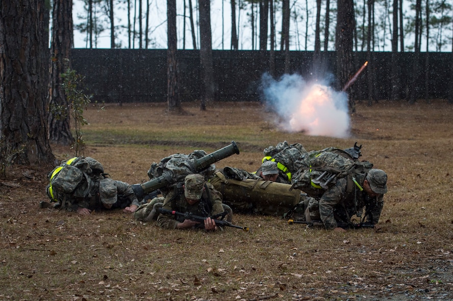 Airmen duck for cover as a non-lethal grenade explodes during a Pre-Ranger Assessment, Feb. 11, 2018, at Moody Air Force Base, Ga. The three-day course is designed to determine whether Airmen are ready to attend the Air Force Ranger Assessment Course held at Fort Bliss Army Post, Texas. (U.S. Air Force photo by Senior Airman Janiqua P. Robinson)