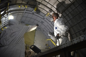 (02/13/2018) -- National Museum of the U.S. Air Force restoration specialist Brian Lindamood paints the bomb bay of the Boeing B-17F Memphis Belle. Plans call for the aircraft to be placed on permanent public display in the WWII Gallery here at the National Museum of the U.S. Air Force on May 17, 2018. (U.S. Air Force photo by Ken LaRock)
