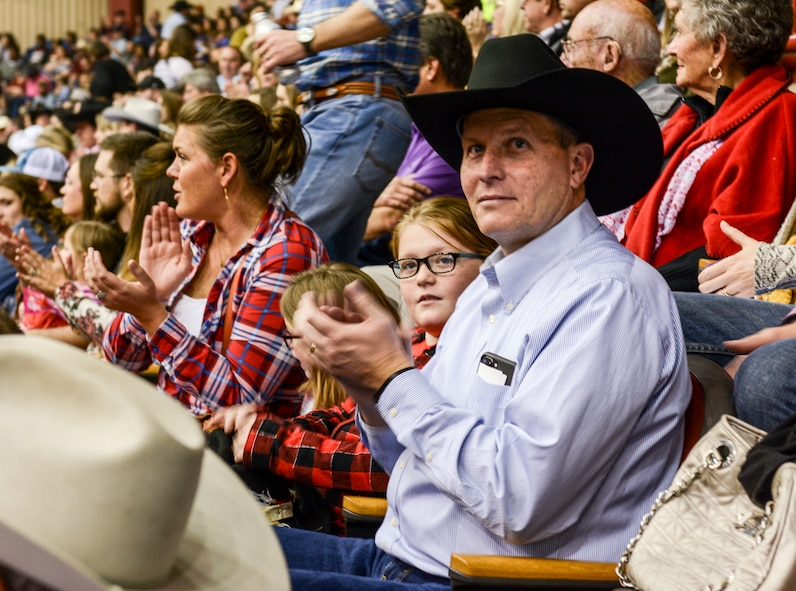 U.S. Air Force Col. Jeffrey Sorrell, 17th Training Wing vice commander, watches the rodeo events with his family during Military Appreciation Night at the San Angelo Stock Show and Rodeo held at the Foster Communications Coliseum, Feb. 14, 2018, San Angelo, Texas. Rodeo events included bronc riding, bull riding, calf roping, steer wrestling, team roping and mutton busting. (U.S. Air Force photo by Aryn Lockhart/Released)