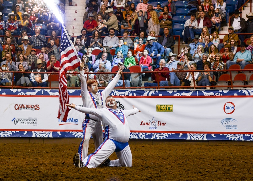To celebrate the Olympics, rodeo clowns perform a rodeo-style figure skating routine to entertain the audience during the Military Appreciation Night at the San Angelo Stock Show and Rodeo held at the Foster Communications Coliseum, Feb. 14, 2018, San Angelo, Texas. The stock show and rodeo provides the largest economic impact of any event held in San Angelo.  (U.S. Air Force photo by Aryn Lockhart/Released)