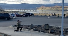 A visitor views eagles through a newly-installed spotting scope at The Dalles Dam Visitor Center, Jan. 2018.