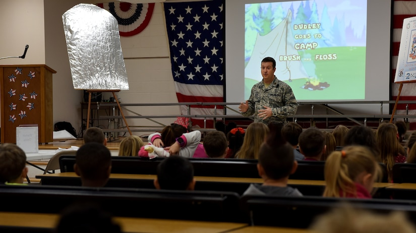 Maj. Chris Jordan, 628th Medical Group Deily Dental Clinic chief of dental services, speaks to students about the importance of dental hygiene during a visit at the Marrington Elementary School Feb. 14, 2018 in South Carolina.