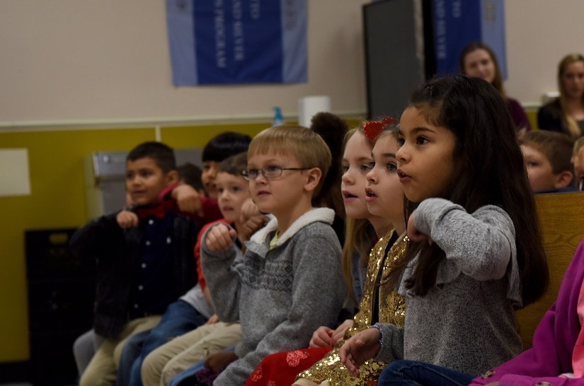 Students interact with the 628th Medical Group Deily Dental Clinic staff workers during a school visit at Marrington Elementary School Feb. 14, 2018, in South Carolina.