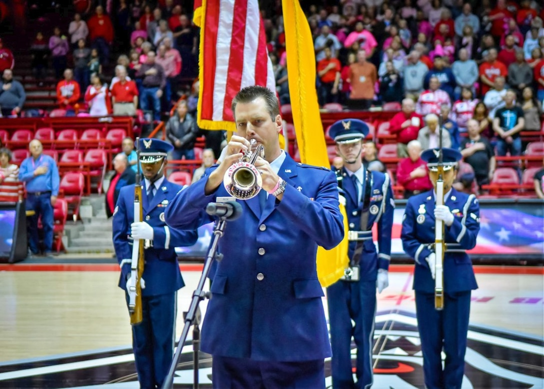 "Kirtland Air Force Base Chaplain Capt. Thomas ""Andy"" Peck performs the National Anthem prior to the Air Force vs. University of New Mexico women's basketball game on Saturday, Feb. 10 at Dreamstyle Arena."