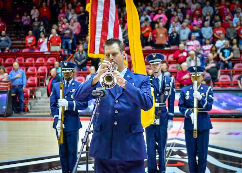 """Kirtland Air Force Base Chaplain Capt. Thomas """"Andy"""" Peck performs the National Anthem prior to the Air Force vs. University of New Mexico women's basketball game on Saturday, Feb. 10 at Dreamstyle Arena."""