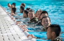 MARINE CORPS BASE CAMP PENDLETON, Calif. – Japan Ground Self Defense Force soldiers participate in a Marine Corps intermediate swim qualification as part of exercise Iron Fist Jan. 16, 2018. Iron Fist brings together U.S. Marines from the 11th Marine Expeditionary Unit and Soldiers from the Japan Ground Self Defense Force, Western Army Infantry Regiment, to improve bilateral planning, communicating, and conduct combined amphibious operations. (U.S. Marine Corps Photo by Cpl. Jacob A. Farbo)