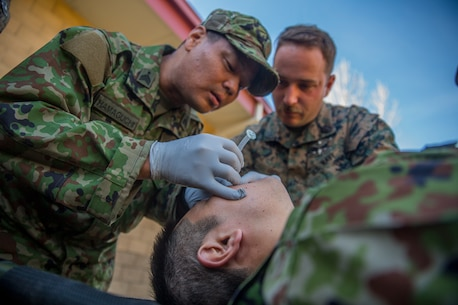 MARINE CORPS BASE CAMP PENDLETON, Calif. – A Japan Ground Self Defense Soldier practices how to use a nasopharyngeal airway while attending a Combat Life Savers Course during exercise Iron Fist 2018, Jan. 17. Exercise Iron Fist is an annual bilateral training exercise where U.S. and Japanese service members train together and share technique, tactics and procedures to improve their combined operational capabilities. (U.S. Marine Corps photo by Lance Cpl. Robert Alejandre)