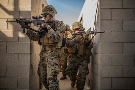 MARINE CORPS BASE CAMP PENDLETON, Calif. - Marines with 1st Combat Engineer Battalion clear hallways during exercise Iron Fist 2018, Jan. 18. Exercise Iron Fist is an annual bilateral training exercise where U.S. and Japanese service members train together and share technique, tactics and procedures to improve their combined operational capabilities. (U.S. Marine Corps photo by Lance Cpl. Robert Alejandre)