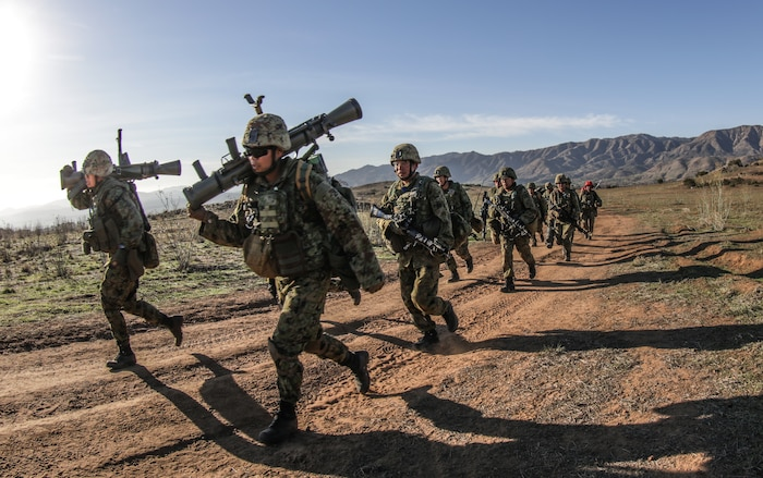 MARINE CORPS BASE CAMP PENDLETON, Calif. – Soldiers with the Western Army Infantry Regiment, Japan Ground Self Defense Force run to their next objective during a live fire and maneuver range aboard Marine Corps Base Camp Pendleton during exercise Iron Fist 2018, Jan. 18. Iron Fist is a five-week-long exercise between the United States Marine Corps and JGSDF focusing on advanced marksmanship, amphibious reconnaissance, fire and maneuver assaults, staff planning, logistical support, medical knowledge sharing, fire support operations, including mortars, artillery and close air support, and amphibious landing operations. (U.S. Marine Corps Photo by Gunnery Sgt. Robert B. Brown Jr.)