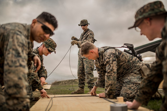 MARINE CORPS BASE CAMP PENDLETON, Calif. – U.S. Marines with 1st Combat Engineer Battalion prepares demolition cable to conduct a simulated roof breach while conducting Urban Explosive Demolitions training during exercise Iron Fist 2018, Jan. 19. Exercise Iron Fist is an annual bilateral training exercise where U.S. and Japanese service members train together and share technique, tactics and procedures to improve their combined operational capabilities. (U.S. Marine Corps photo by Lance Cpl. Robert Alejandre)
